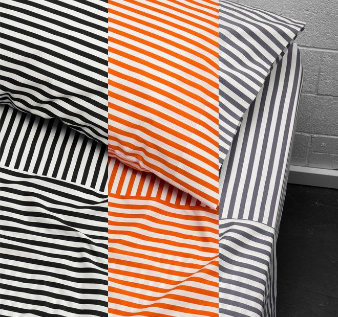 Umbrella Striped AURA  All the best things have stripes - paper straws, lighthouses, shirts and umbrellas - they're a hallmark of elegance and a throwback to classic French audacity. Bold lines of black, smoke and orange imprint themselves upon the softest cotton, leaving their mark in no uncertain terms. These are sheets a la mode, an expression of style that echoes the Riviera.  Features: Cotton 250 thread count Printed Deep 50cm wall on fitted sheet - #sheets