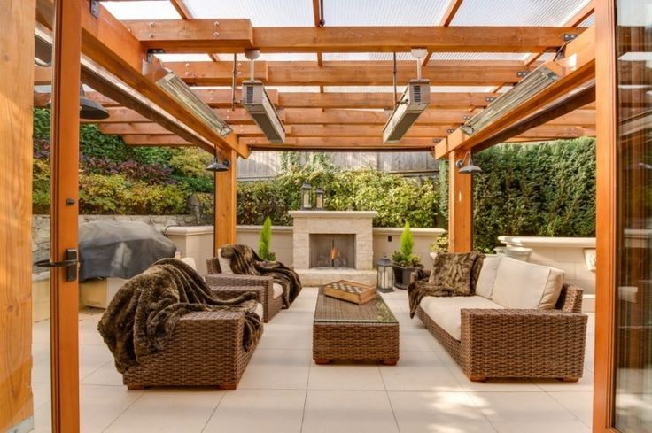 wood pergola idea with outdoor lighting fixtures patio heater a set of rattan made furniture with puff comforters concrete tiles floors of Turn Your Backyard into Inviting Spot just with These Pergola Designs for Patio