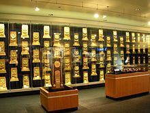 National Collegiate Athletic Association National Championship Trophies, Rings, and Watches worn by UCLA Teams.