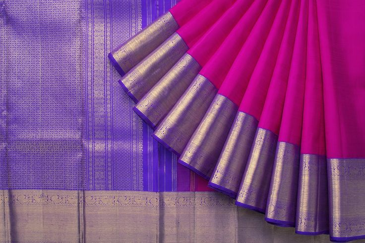 A bright diamond patterned Kanjivaram in pink and blue.