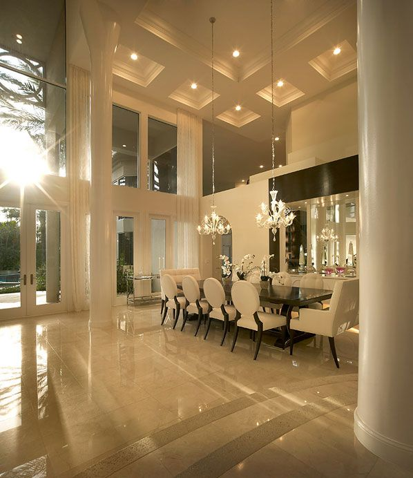 Stunning dining room with beautiful coffered ceilings, high gloss floors, and tall pillars - absolutely gorgeous! #design #diningroom #luxury