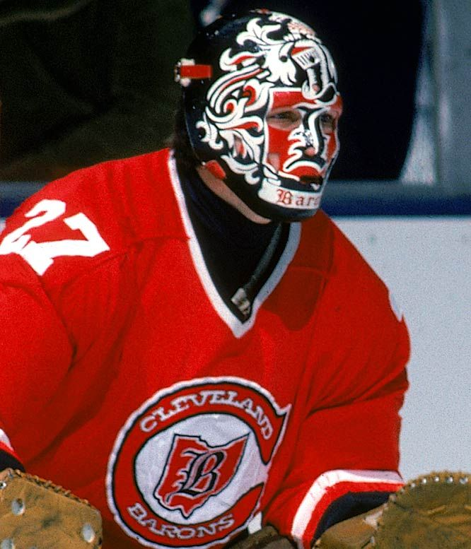 """Meloche's """"heraldry"""" mask was designed by Harrison, who created his own Cleveland crest for Meloche after the California Golden Seals moved ..."""