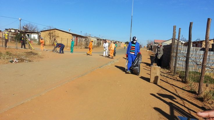 Cleaning open spaces in Lesedi Local Municipality ext. 23 and 26 for Mandela Day. Picture: Katty Rakitla