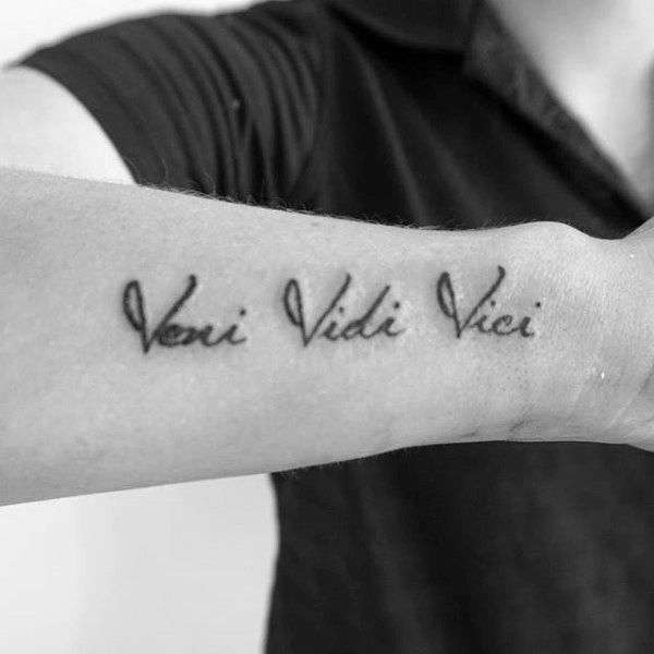 Gentleman With Veni Vidi Vici Tattoo On Wrist