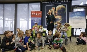 Party of schoolchildren visiting Iowa botanical garden become part of backdrop for Republican presidential candidate's speech on abortion