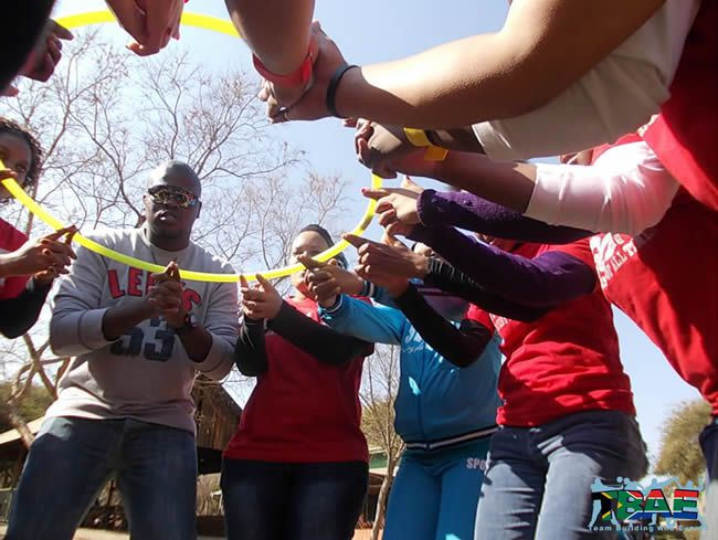 Hula Hoop Down - This activity is definitely much harder than it looks. The team stands in a circle, and the objective is to move the Hula Hoop down from above waste height to the ground. There are certain restrictions in terms of how the Hula Hoop is allowed to be held.
