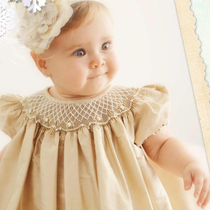This beautiful pale gold silk bishop smocked dress made by Will'Beth is available at www.grammies-attic.com.