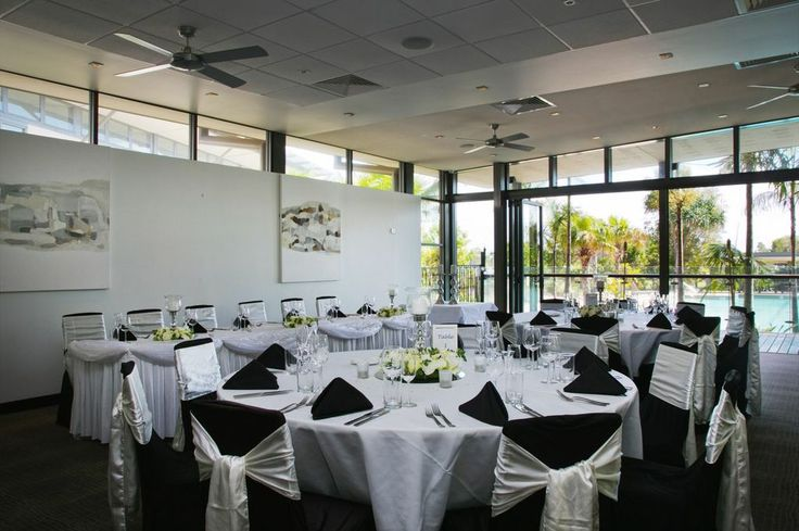 Setting up by the pool. Pacific Harbour Golf and Country Club is a gorgeous location for your reception. Call (07) 3410 4001 today to enquire about bookings!