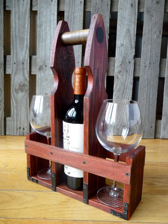Save the planet by using this super stylish and sturdy tote made specifically for standard size wine bottles, 22oz. beer or cider bottles and even a couple of glasses. Created with reclaimed cedar wood fence posts and distressed to a beautiful dark red and walnut rustic finish. Lightweight but sturdy enough to hold the weight of the wine. Measures approximately 17w x 4d x 12w Original piece made with love by Amanda