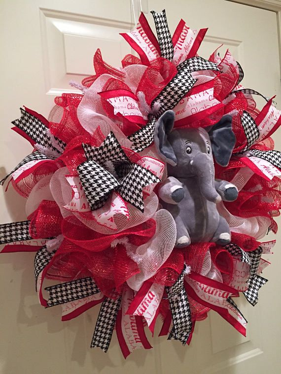Got a die-hard Alabama fan in your family - this wreath is perfect for any front door, accent piece, or a Bama Babys room. The plush elephant Big Al and Alabama Ribbon with Houndstooth Ribbon accents just scream Alabama. This would be such a fun wreath for a future Razorback fans room. Diameter: 24