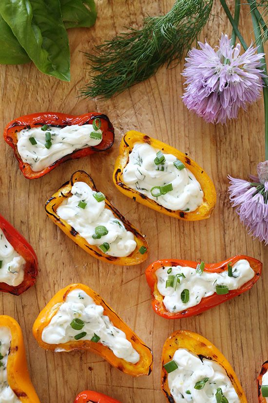 These mini peppers are grilled until slightly charred and filled with an herb cream cheese. A great appetizer to make for the summer!  The peppers only take about 2 minutes on each side to cook, and they smell incredible as they begin to char. You can make them ahead and keep them chilled until ready to serve.     The herb cream cheese is so flavorful, with all my favorite garden herbs. You can use any combination you wish. Here I used dill, chives and basil with a little lemon zest to…