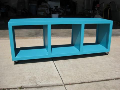 Cubby Bench- build it yourself plan.  Add fabric cushion on top (for the playroom)