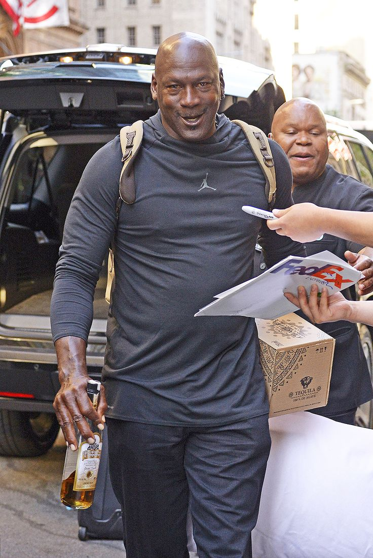 Michael Jordan carries a Tequila bottle and pillow while checking out of his hotel in New York City Pictured: Michael Jordan Ref: SPL5003626 140618 NON-EXCLUSIVE Picture by: Edward Opi / SplashNews.com Splash News and Pictures Los Angeles: 310-821-2666 New York: 212-619-2666 London: 0207 644 7656 Milan: +39 02 4399 8577 photodesk@splashnews.com World Rights
