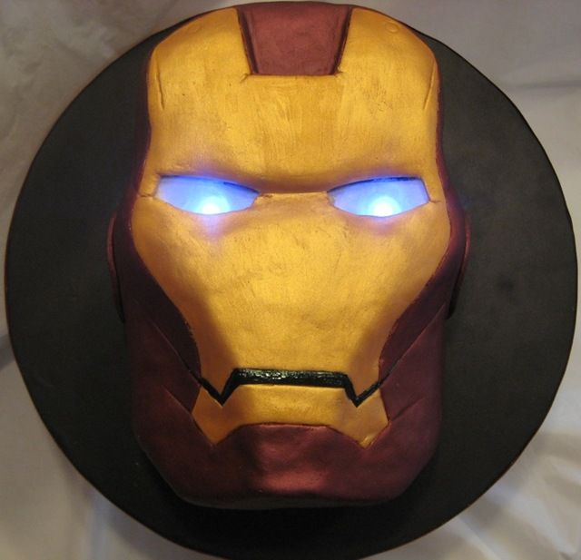 Iron Man Cake - featuring light-up eyes made from LEDs and parchment paper. If someone wants to make me a cake and it happened to be this I would love them forever