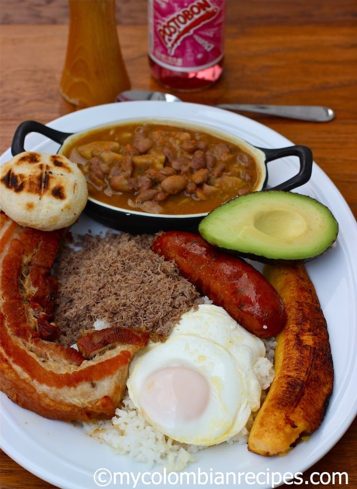 "BANDEJA PAISA - ""Tradionally, Bandeja paisa includes beans, white rice, chicharrón, carne en polvo, chorizo, fried egg, ripe plantain, avocado and arepa, but you can substitute the powdered beef for grilled beef or pork."""