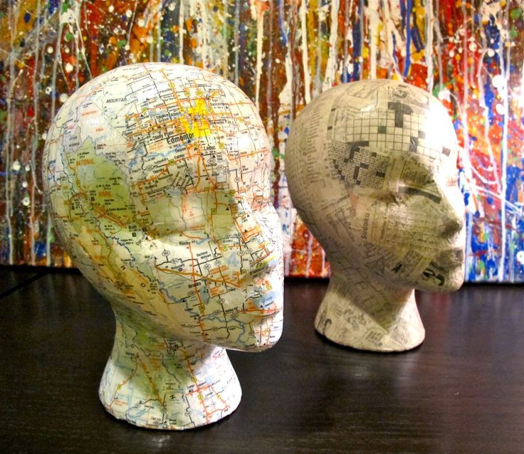 Decoupage mannequin heads - Not sure why but these are super cool to me!