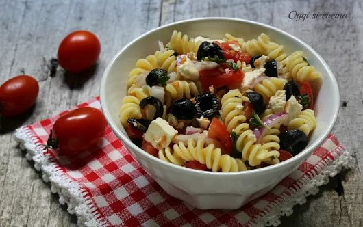 This Greek-inspired pasta dish combines the quintessential flavours of the eastern Mediterranean - olive oil, tomatoes, oregano and feta.  You can make it!  Bring a large pot of lightly salted water to the boil. Plunge whole tomatoes in water briefly, until skin starts to peel. Remove with a slotted spoon and place in cold water. Add pasta to boiling water and cook according to package instructions; drain.  While pasta is cooking peel blanched tomatoes and chop. In a large frying pan over