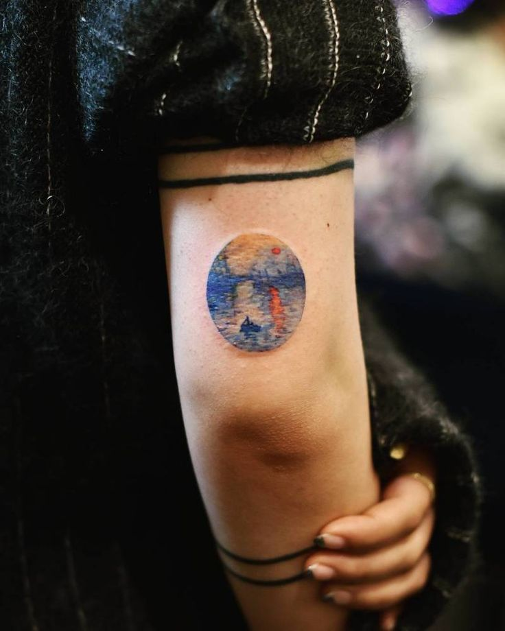 Claude Monet's 'Impression, Sunrise' inspired tattoo on the back of the right arm.