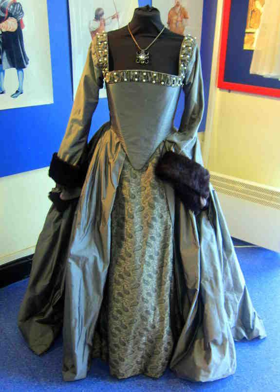 Check out this website - an encyclopedia of the costumes in The Tudors. This is one of Anne Boleyn's dresses.