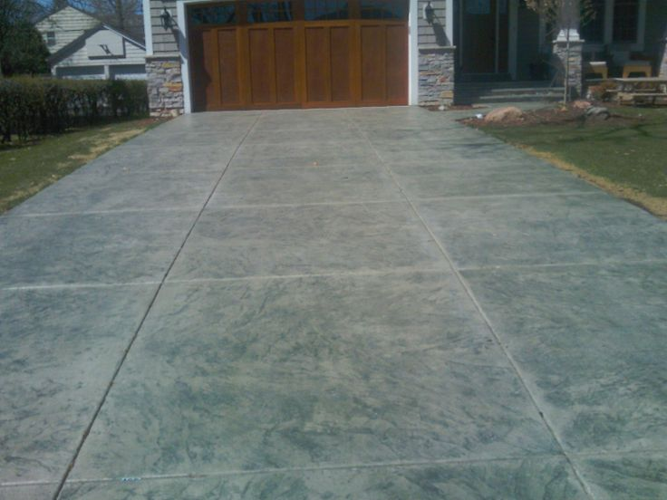 Concrete Driveway Design Ideas include a design at intersecting points of your driveway to create a focal point commonly chosen items are compass designs logos address numbers Stamped Concrete Driveway Idea