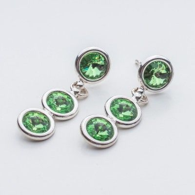 Swarovski Rivoli Earrings 6/6/6mm Peridot  Dimensions: length: 3,2cm stone size: 6mm Weight ( silver) ~ 3,30g ( 1 pair ) Weight ( silver + stones) ~ 3,95g Metal : sterling silver ( AG-925) Stones: Swarovski Elements 1122 SS29 ( 6mm ) Colour: Peridot 1 package = 1 pair  Price 9 EUR