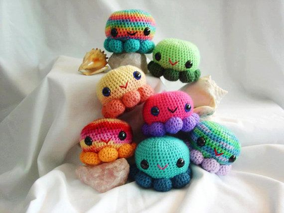 We did a mini photo shoot with these guys yesterday! So bright and fun!!  Amigurumi OctoSqueedle by RavensCraftCreations