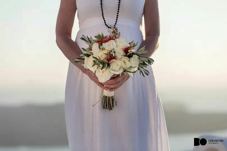 Bridal bouquet with white roses, olive leaves and wild herbals Www.santoweddingsbymk.com
