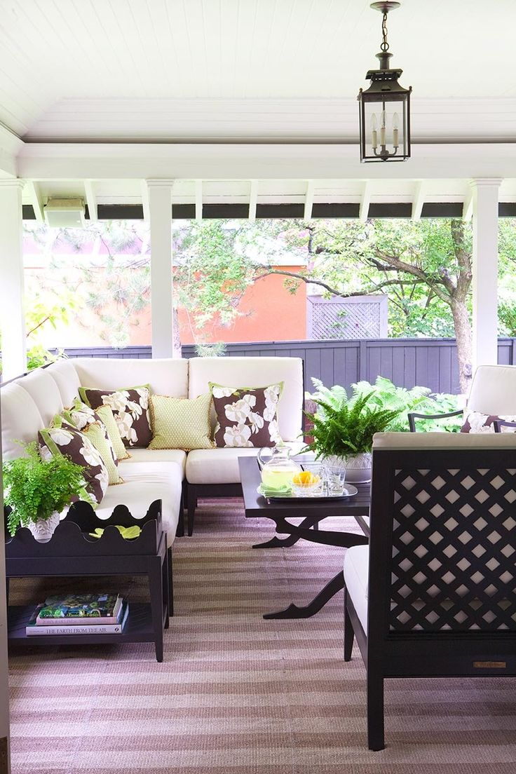 Covered Porch with Black & White Furniture, striped rug and outdoor pendant light - Anne Hepfer