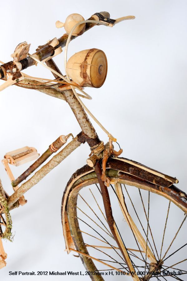 Wood, Ash, Willow #sculpture by #sculptor Michael West titled: 'Self Portrait (Willow Ash and Wood Bicycle Willow statue)'. #MichaelWest