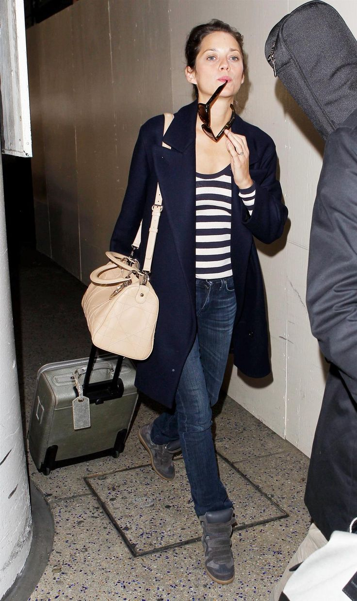 Marion Cotillard arriving at LAX, October 21th//If anyone can wear those Isabel Marant shoes, it's MC.