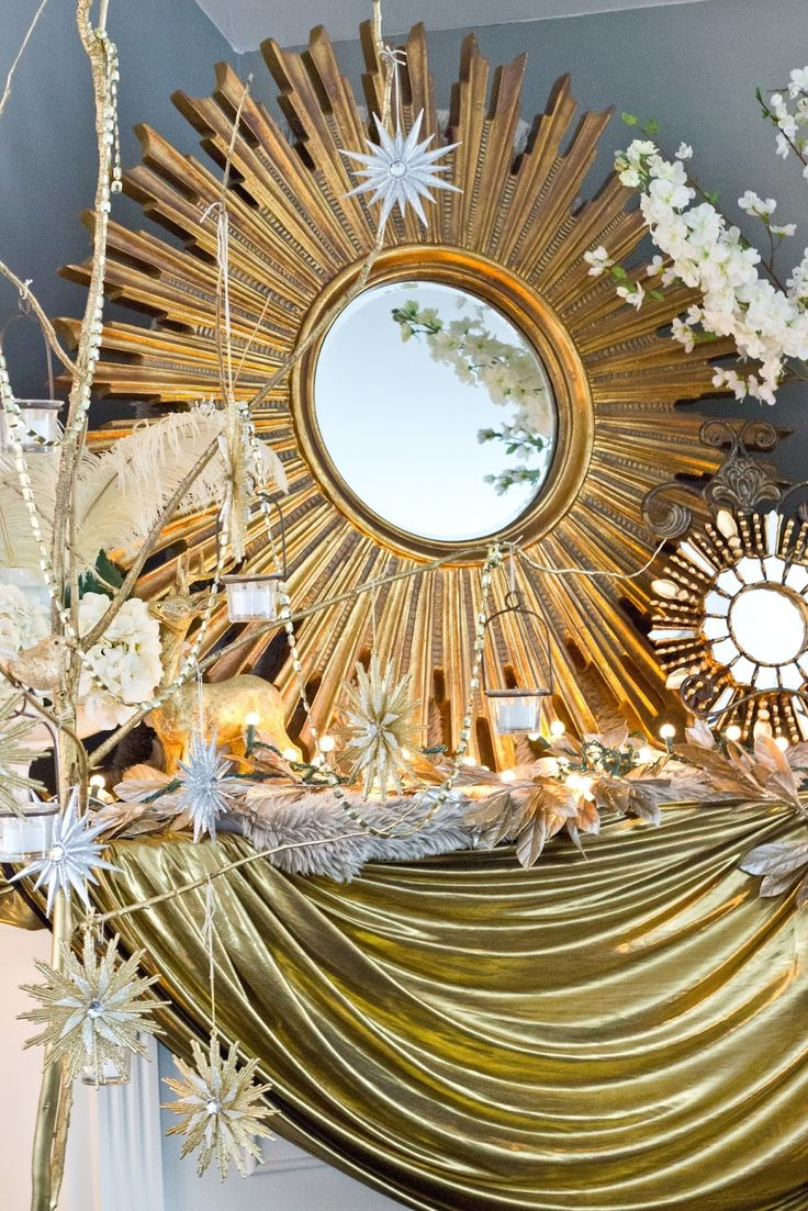 sunburst mirrors with a swag of gold lam fabric