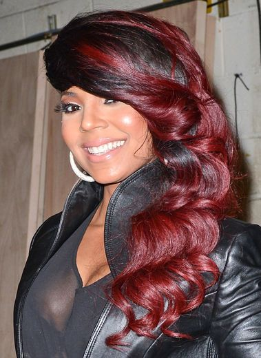 OMG!  I love this COLOR and STYLE! Ashanti's whipped waves are hotter than hot. While we wouldn't think of this as an everyday look, it fits with Ashanti's funky style.
