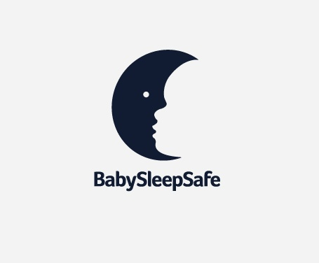 """""""BabySleepSafe"""" #logo shows a Moon in black and a happily sleeping baby face in the negative space"""