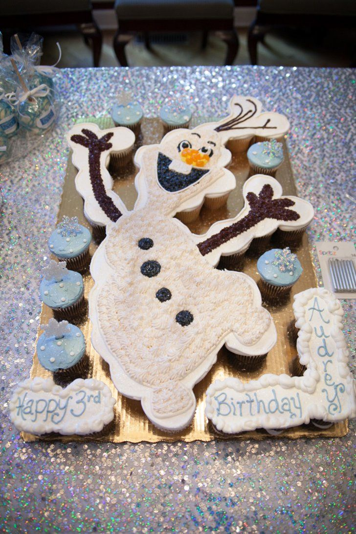 Pin for Later: Let It Bake! 16 Droolworthy Cakes Inspired by Disney's Frozen A Cupcake Cake This adorable Olaf cupcake arrangement was ordered at the local Publix grocery store's bakery. It turned out perfectly!