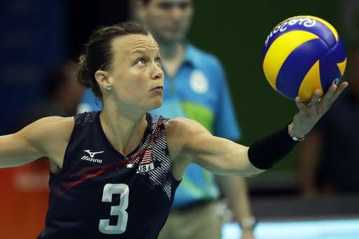 Top-ranked US women's volleyball team goes unbeaten in group:   August 14, 2016  -    United States' Courtney Thompson serves the ball during a women's preliminary volleyball match against China at the 2016 Summer Olympics in Rio de Janeiro, Brazil, Sunday, Aug. 14, 2016. (AP Photo/Matt Rourke)