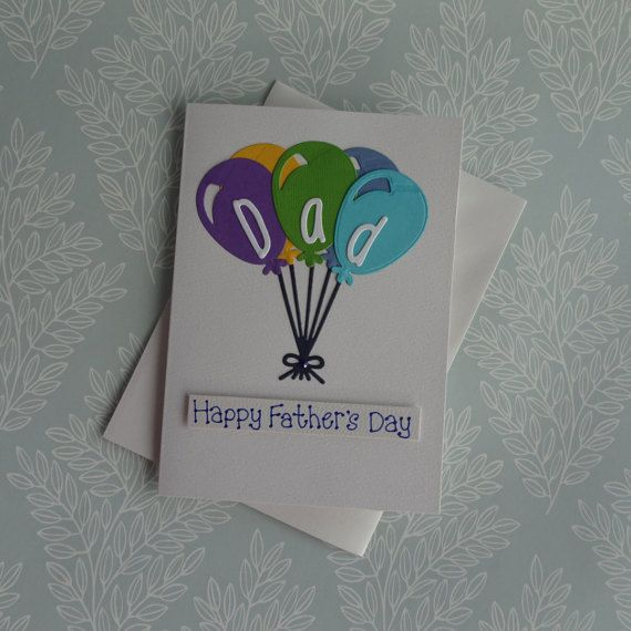 Unique Fathers Day balloon card. Handmade card for Dad with a bunch of balloons.  This handmade card has a bunch of balloons in bright colours (although you can choose alternative colours from the drop-down menu) and a gem added to the bow at the bottom of the strings of the balloons. The sentiment on this Happy Fathers Day card is added with 3D foam and reads: Happy Fathers Day. The message is added with blue ink.  FRONT OF THE CARD: The card can be personalised (personalized) with the…