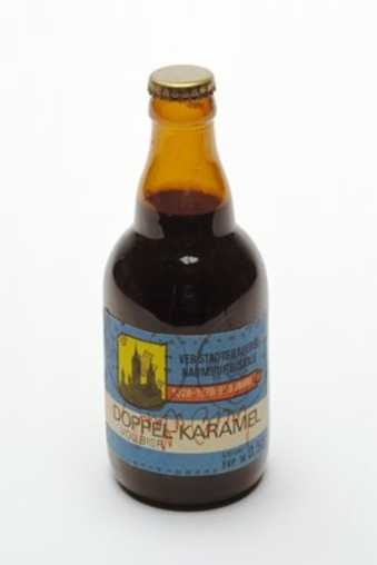 brown glass bottle filled with liquid, with printed label