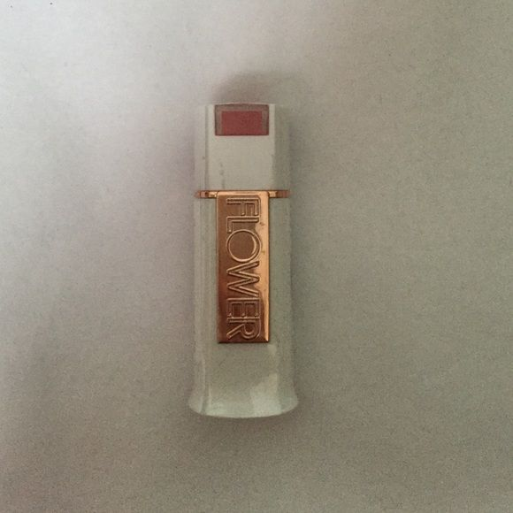 Flower brand lipstick in deep red color Flower brand lipstick in LS8 or get to the poinsettia color, red, unopened and brand new. Flower Makeup Lipstick