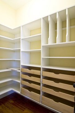 Maximizing every square inch of a closet. Love the corner shelves and drawers.