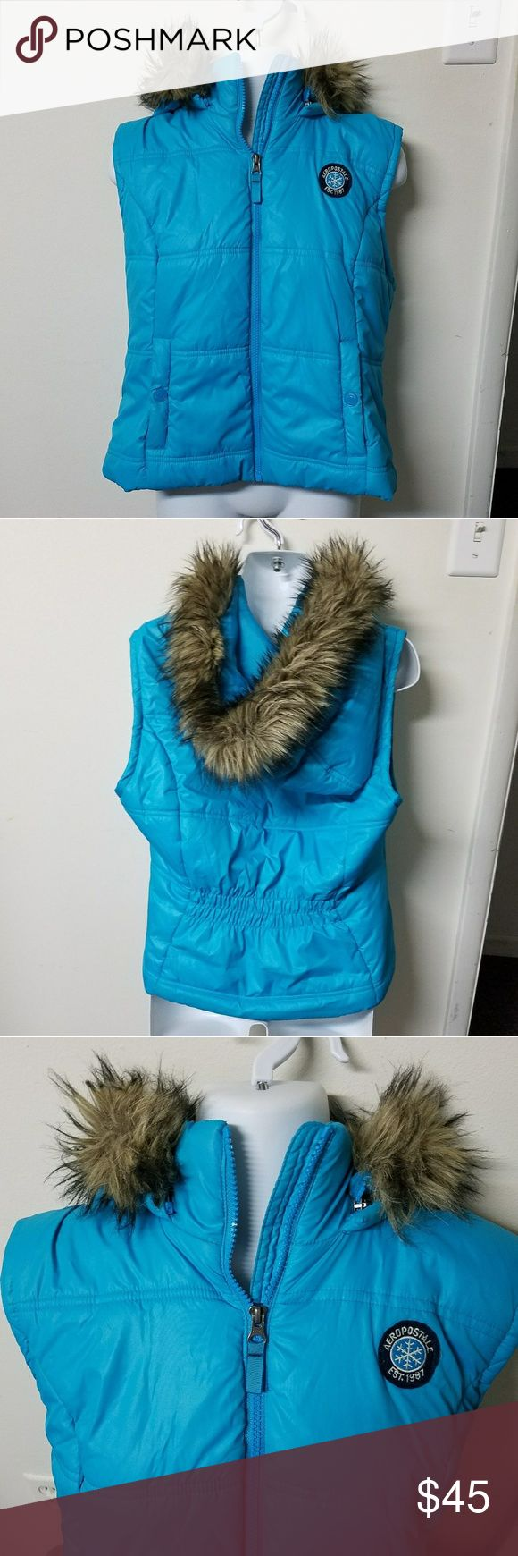 Aeropostale SKY blue puffy vest detach hood XL EUC Up for sale is a juniors XL Aeropostale puffy vest. It is a gorgeous and lovely sky blue. It is in excellent condition, all zippers and snaps in perfect shape. Nice subtle Aero logo. Purchased direct from Aero, not sold for a long time. Yes, this actually warm.  Super cute lining inside.   Faux fur hood is detachable. 20.5 in pit to pit x 20 inches long zipped.   Thanks for looking and please ask any questions!! ❤❤ Aeropostale Jackets…