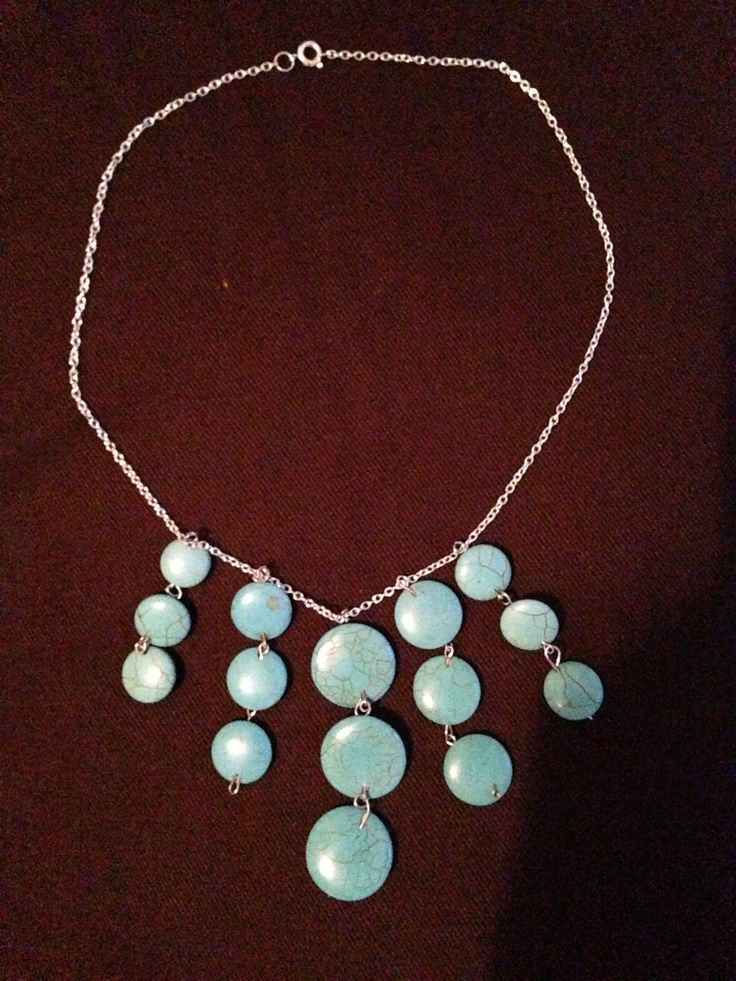 handmade by me.  Turquoise coloured beads on a silver plated chain