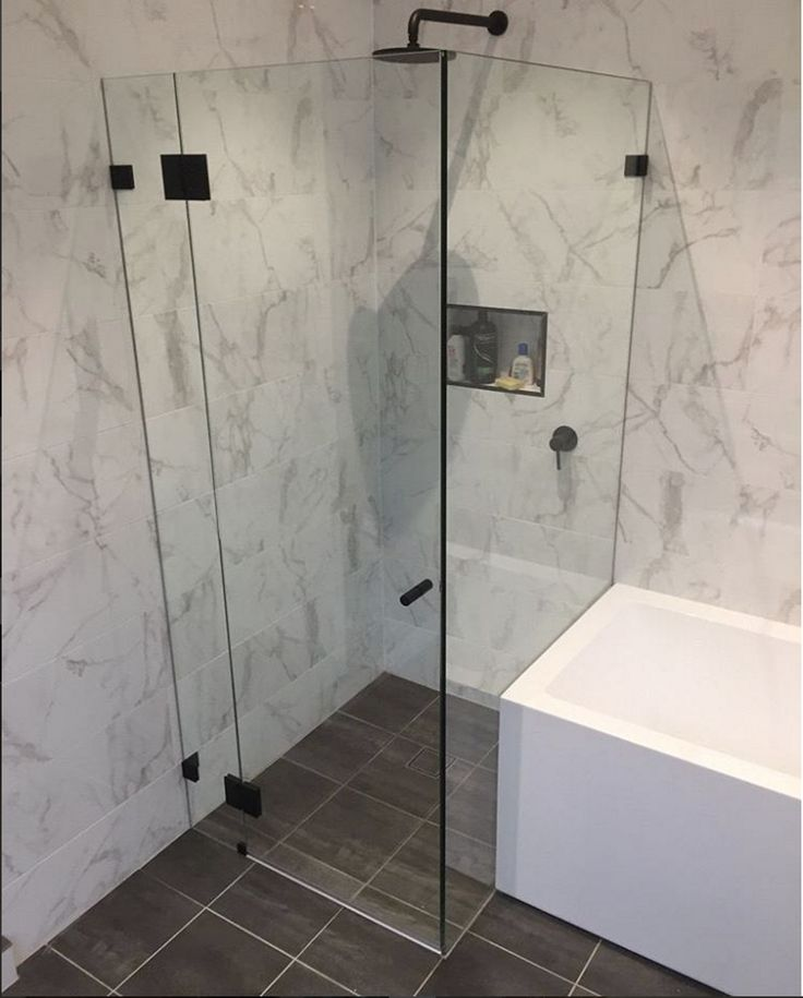 lukes renovation team have completed this bathroom reno- where they incorporated Carrara tiles with matte black fixtures- creating a modern , stylish bathroom at an affordable cost !