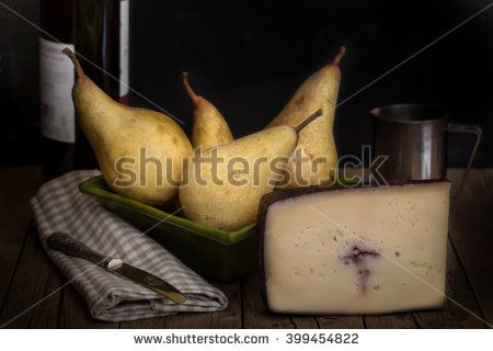 Classic low key still life with cheese and pears.#foodphotos #stockphotos #healthyfood #foodingredients #fruits #ItalianFood #Shutterstock #bio #naturalfood #eatingwell