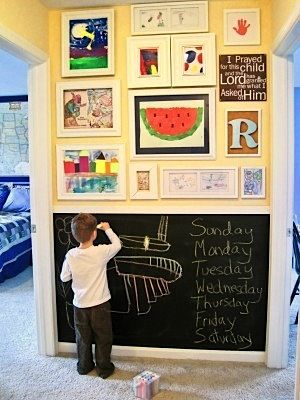 Hallway wall with chalk board paint. I also love how the childrens' art work is so prominently displayed in frames. #chalkboardwall #framedart