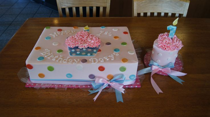 Baby pink birthday sheet cake with polka dots and matching smash cake