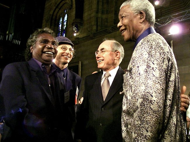 "Former South African president Nelson Mandela with Yothu Yindi lead singer Manduway Yununpingu, Professor Allan Snyder and former Australian Prime Minister John Howard at the launch of the ""What Makes a Champion"" forum at the University of Sydney."