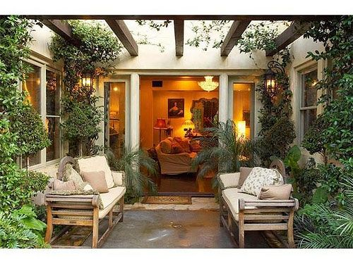 If I could design whatever type of house I wanted it would be an atrium style with a courtyard like this in the middle.