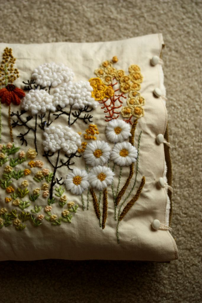 Embroidered flowers on a pillow. Lush!