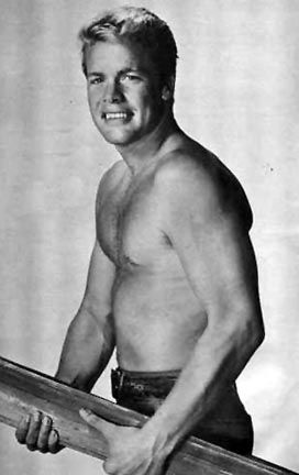 Dough McClure when he was 'one of the beach-bum' surfer guys in the movie Gidget (1959) - his character's name was Waikiki. Most would come to know him best as Trampus on TVs The Virginian