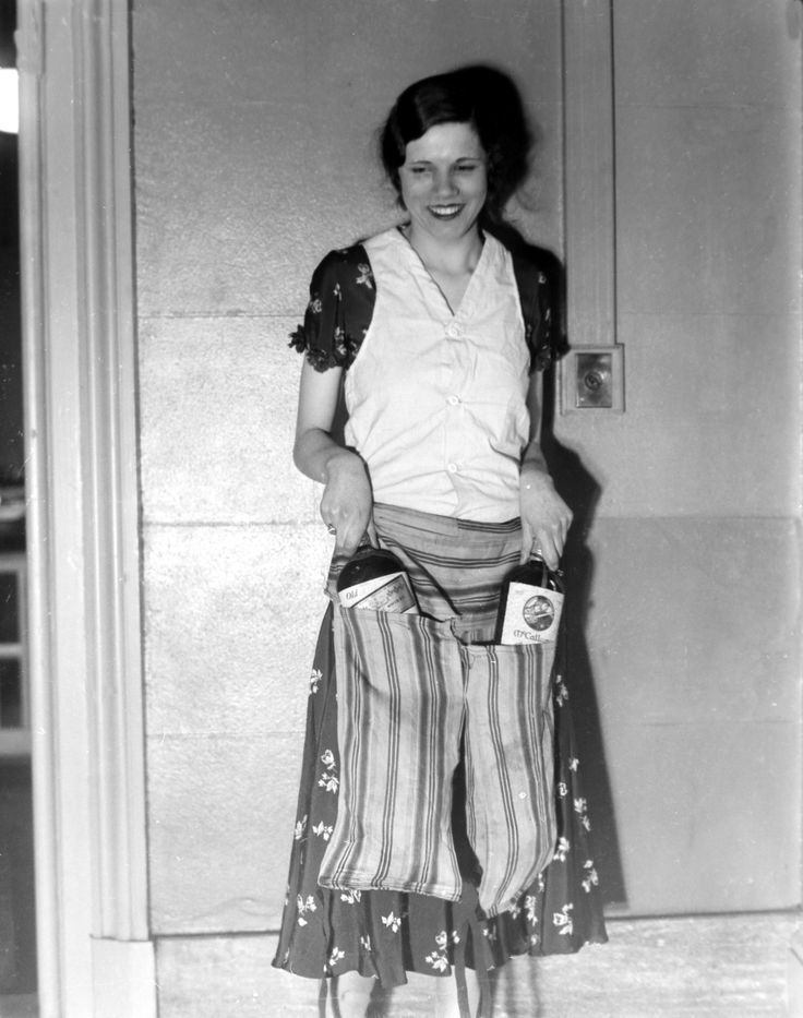 Estelle Zemon shows the vest and pant-apron used to conceal bottles of alcohol to deceive border guards during the U.S. alcohol prohibition on March 18, 1931. (AP Photo) Ref #: PA.3874951  Date: 18/03/1931
